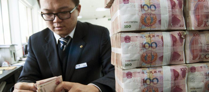 Las reservas de divisas de China cayeron en 41.000 millones de dólares en diciembre a 3,011...