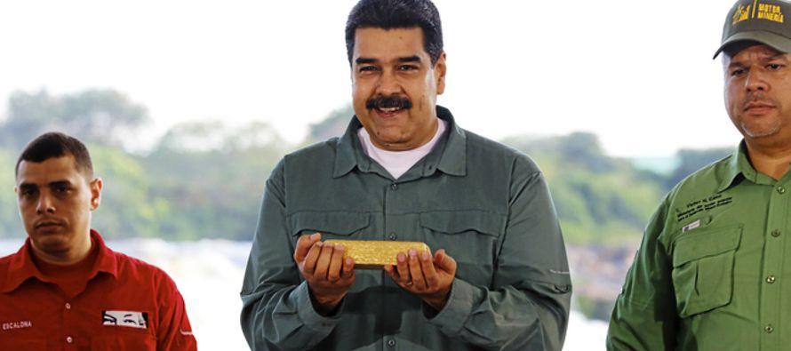 Venezuela encara hoy las terceras elecciones en cinco meses con un nuevo default parcial por...