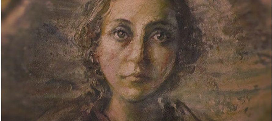 En la capilla de los dominicos, postrada de hinojos ante la imagen de la Virgen del Rosario,...