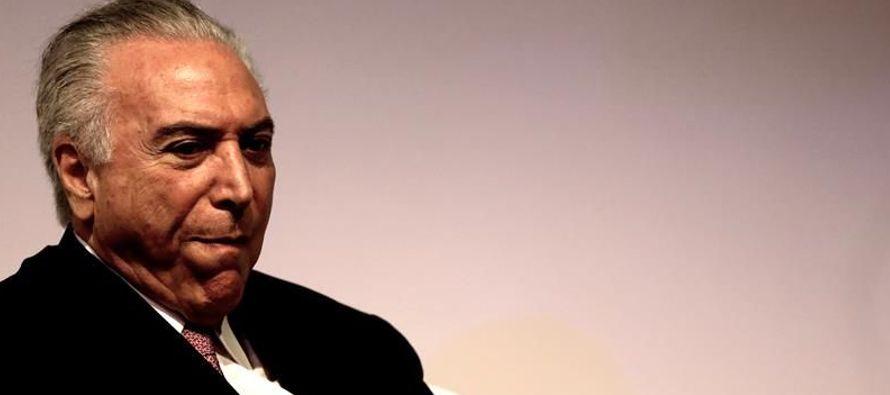 En ese año, Temer ejercía como vicepresidente de Dilma Rousseff y, junto con Padilha...