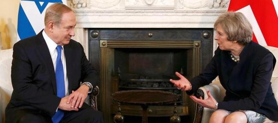 """May dijo que su Gobierno seguirá """"comprometido"""" con el pacto multilateral, del que..."""