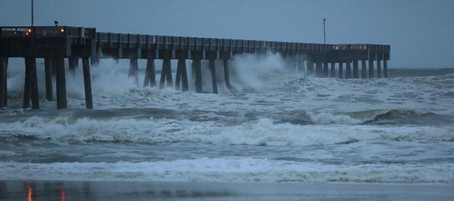 El huracán Michael registraba vientos de 210 kilómetros por hora horas antes de que,...