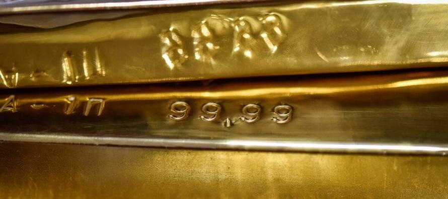 Oro cae bajo 1,200 dlr/onza por avance dólar cerca de máximo 16 meses
